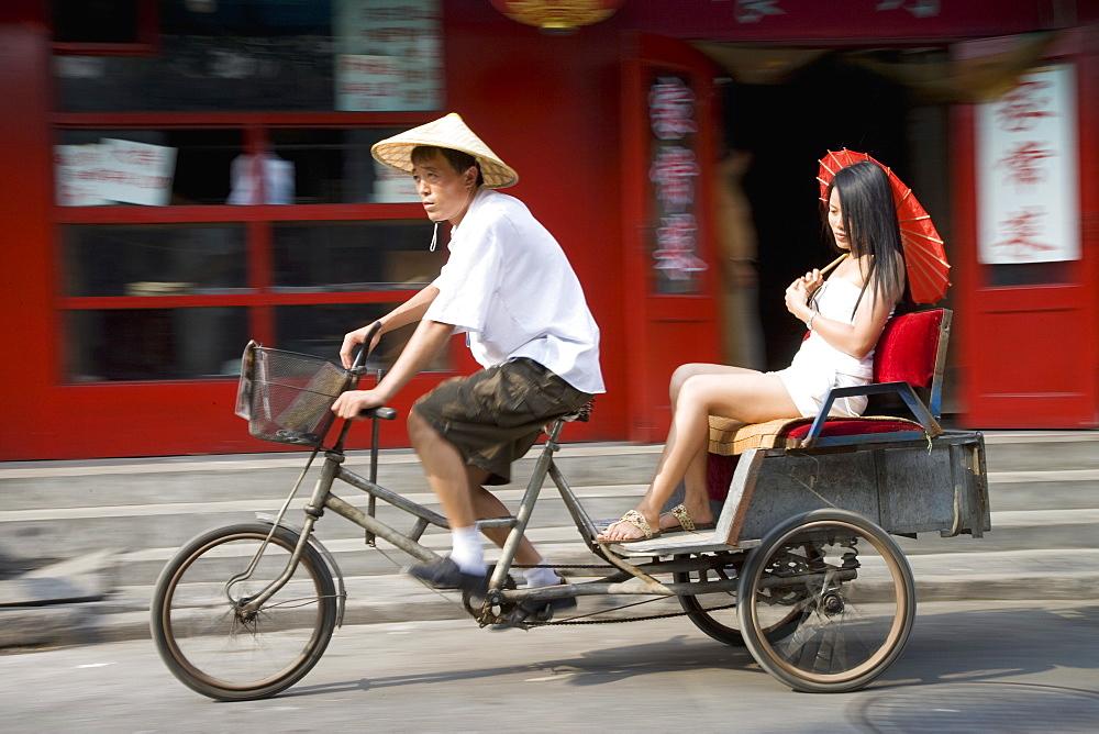 Asian woman (Chinese-Thai) in cycle rickshaw, Hutong District, Beijing, China, Asia