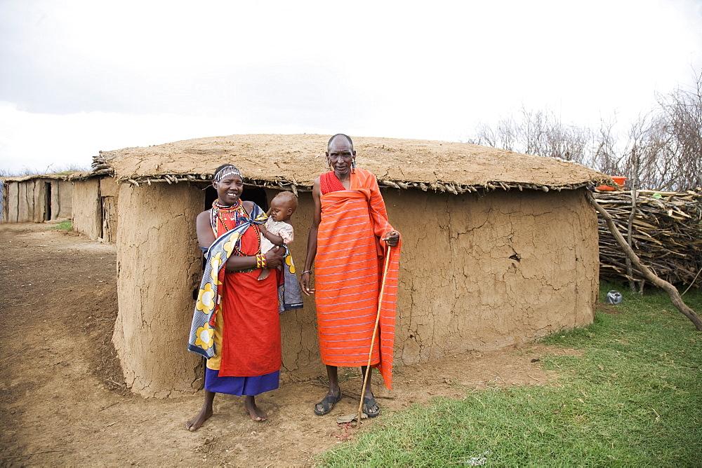 Masai couple and baby, Masai Mara National Reserve, Kenya, East Africa, Africa