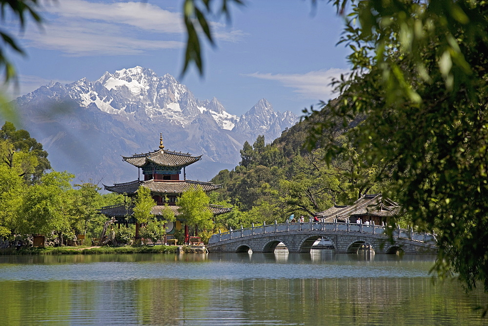 Black Dragon Pool Park, temple and bridge, with Jade Dragon Snow Mountain in background, Lijiang, Yunnan Province, China, Asia