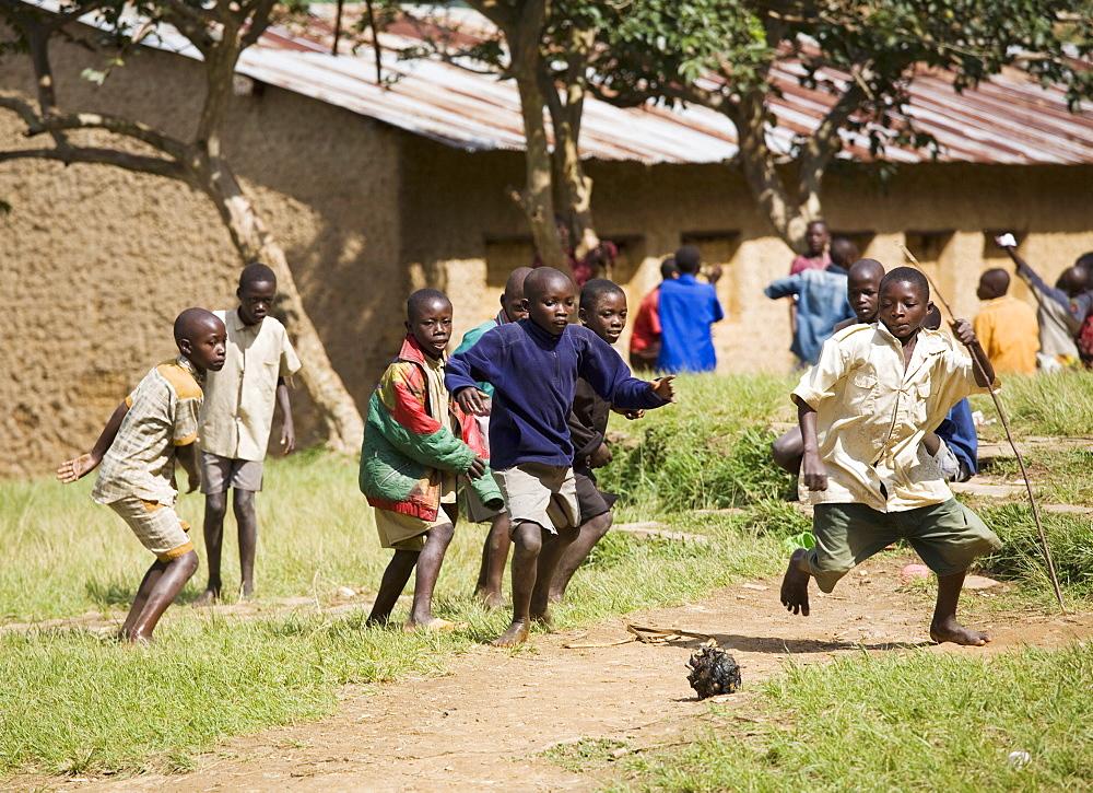 Boys playing football, Village of Masango, Cibitoke Province, Burundi, Africa