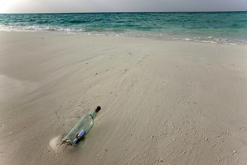 Message in a bottle on a tropical beach, Kuramathi Island, Ari Atoll, Maldives, Indian Ocean, Asia