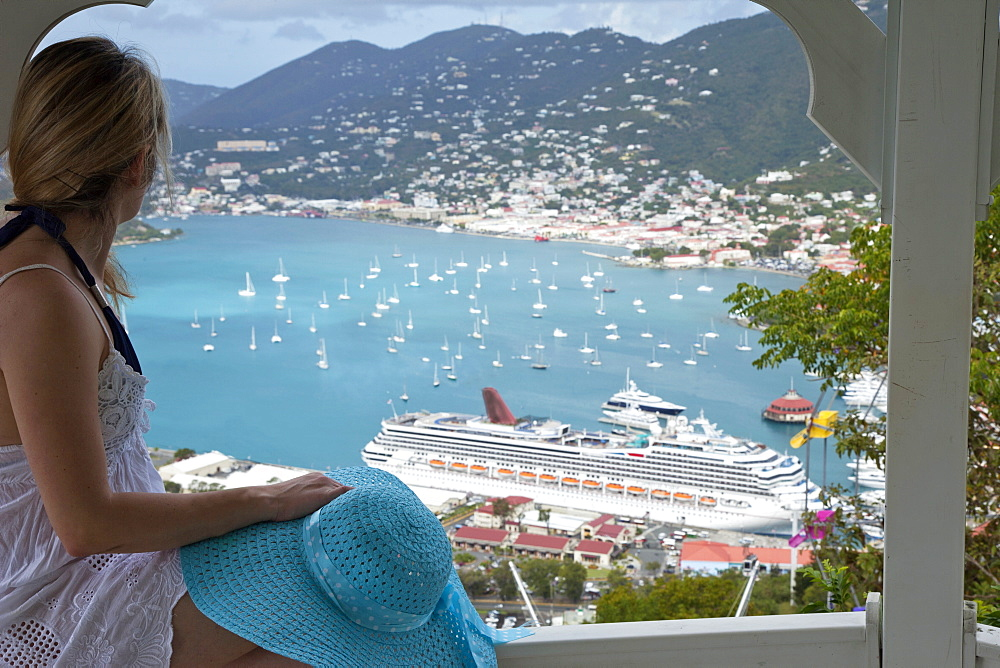Woman looking at cruise ship in port, Charlotte Amalie, St. Thomas, U.S. Virgin Islands, West Indies, Caribbean, Central America