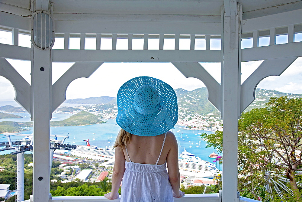 Young woman watching cruise ships in port, Charlotte Amalie, St. Thomas, U.S. Virgin Islands, West Indies, Caribbean, Central America