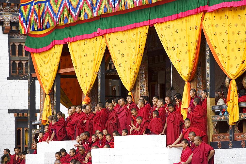 Buddhist monks watching festival (Tsechu), Trashi Chhoe Dzong, Thimphu, Bhutan, Asia - 772-365