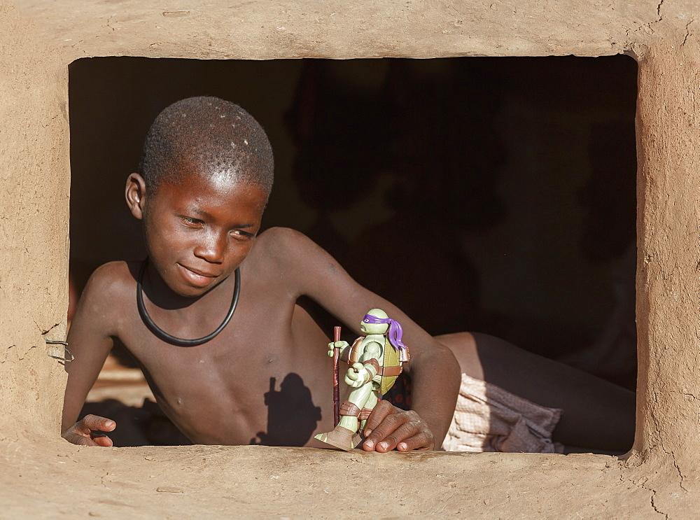 Himba boy with toy, Kaokoland, Namibia, Africa