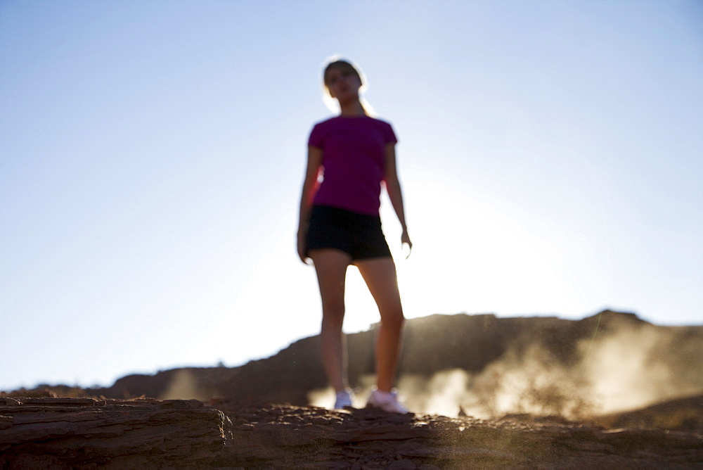 Woman jogging, Monument Valley Navajo Tribal Park, Arizona Utah border, United States of America, North America
