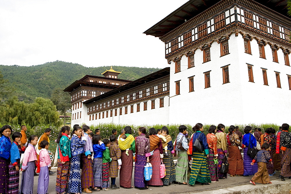 Women entering temple for Buddhist festival (Tsechu), Trashi Chhoe Dzong, Thimphu, Bhutan, Asia - 772-99