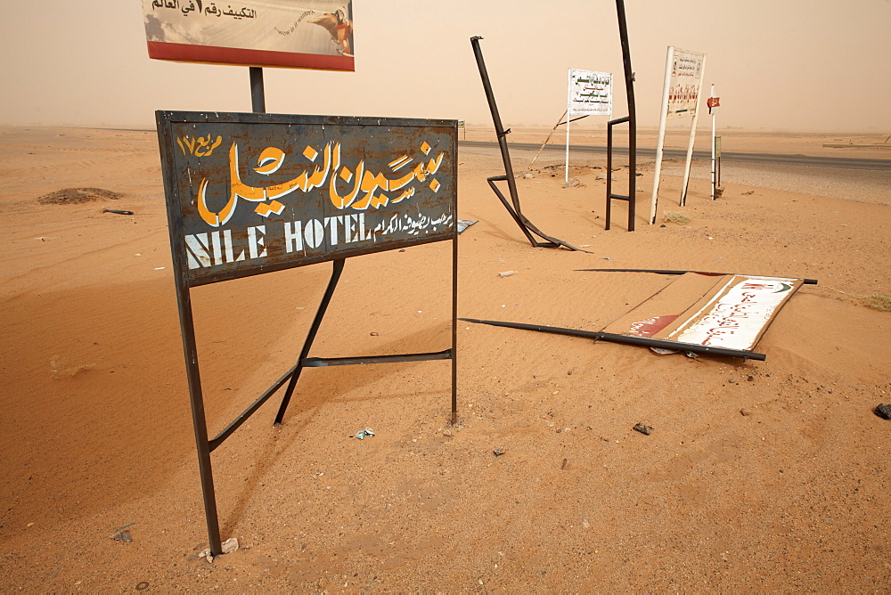 Signposts stand in the desert along the Khartoum to Atbara highway, Sudan, Africa