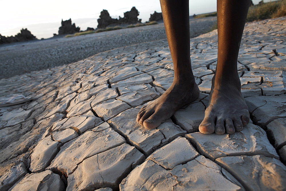 Standing in the desolate landscape of Lac Abbe, Djibouti, Africa