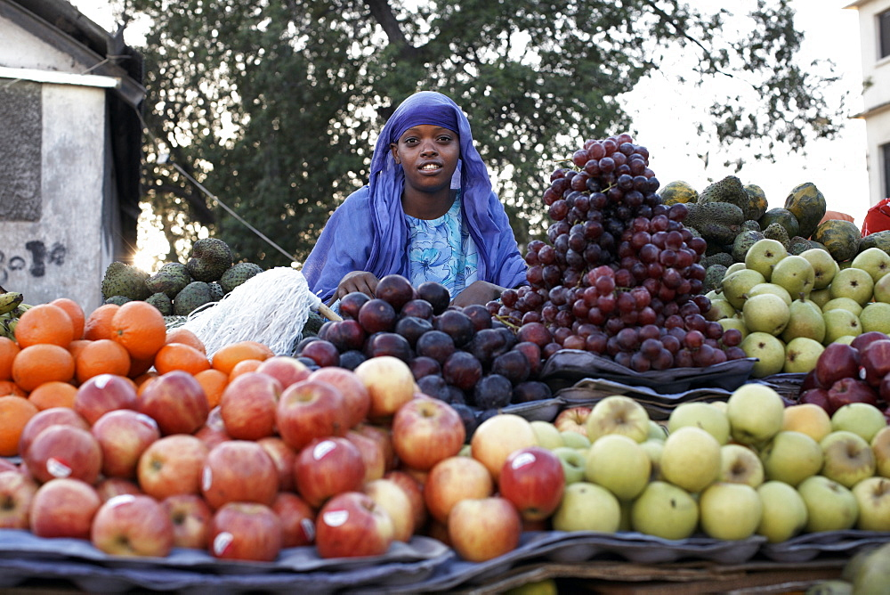 A girl selling fruit in the European Quarter of Djibouti City, Djibouti, Africa