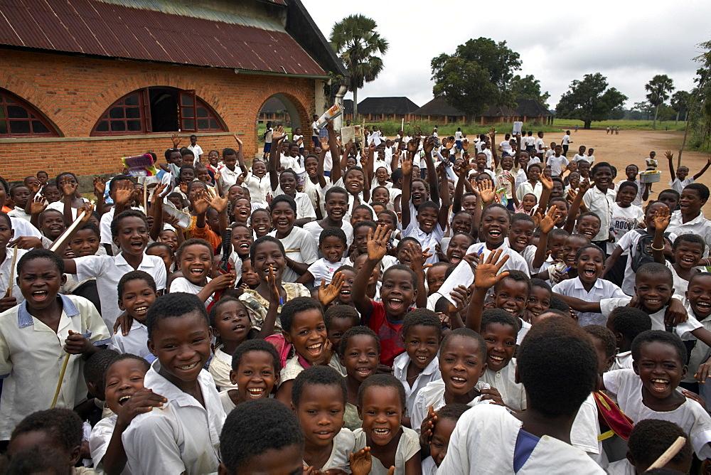 School children enjoy having their picture taken, in Yangambi, Democratic Republic of Congo, Africa - 774-828