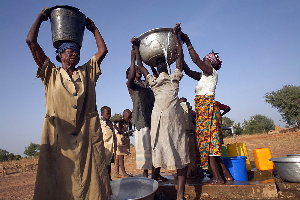 Villagers collect water near Nandom, Ghana, West Africa, Africa