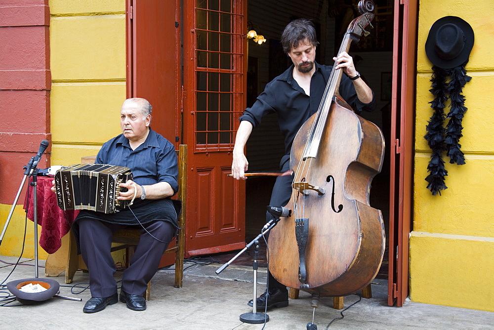 Musicians on El Caminito street in La Boca District of Buenos Aires, Argentina, South America
