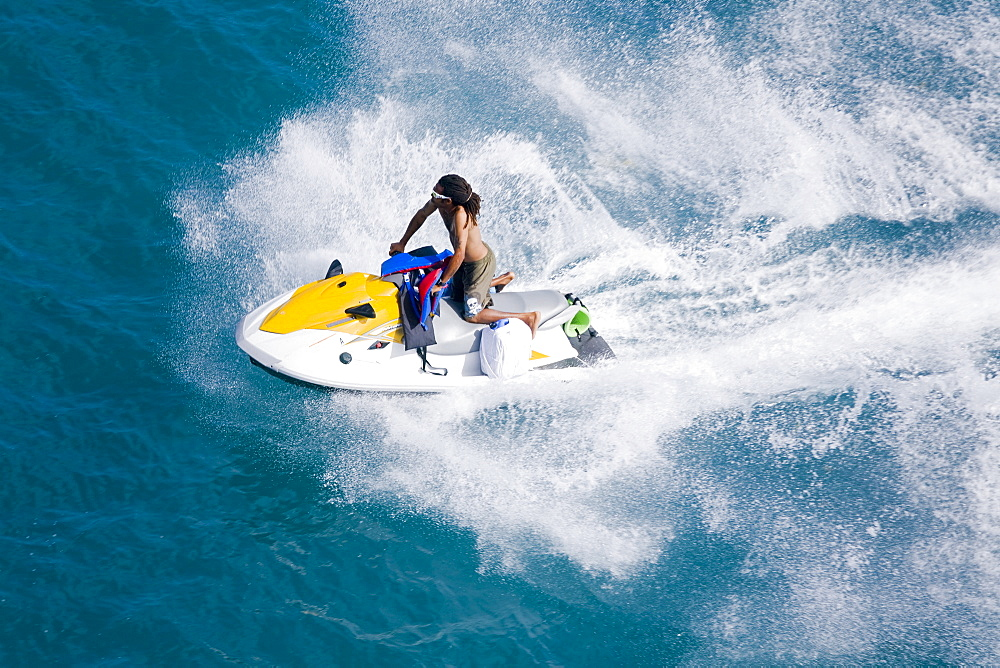 Man on a jet ski, Nassau harbor, New Providence Island, Bahamas, West Indies, Central America