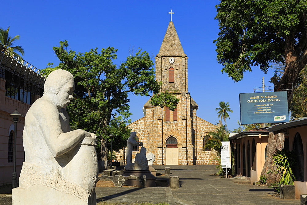 Sculpture by Rodolfo Ramirez and Cathedral, Puntarenas City, Costa Rica, Central America