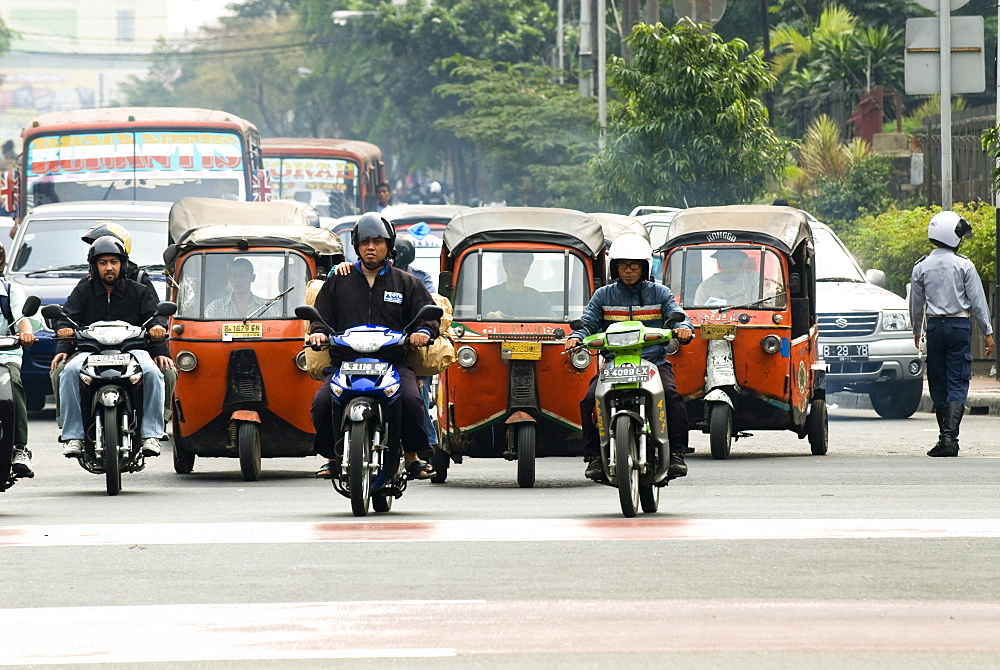 Traffic including tuk-tuk or bajaj, Jakarta, Java, Indonesia, Southeast Asia, Asia