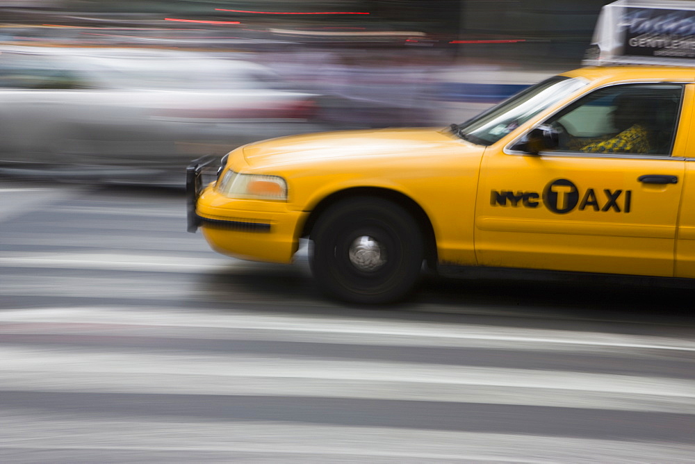 New York taxi cab driving fast over a pedestrian crossing, Manhattan, New York, United States of America, North America