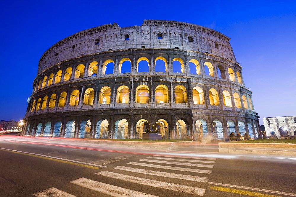 Colosseum amphitheatre, UNESCO World Heritage Site, and via Dei Fori Imperiali at night, Rome, Lazio, Italy, Europe