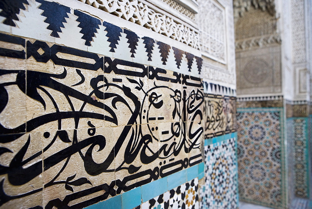 Arabic calligraphy and Zellij tilework, Bou Inania Medersa, Meknes, Morocco, North Africa, Africa