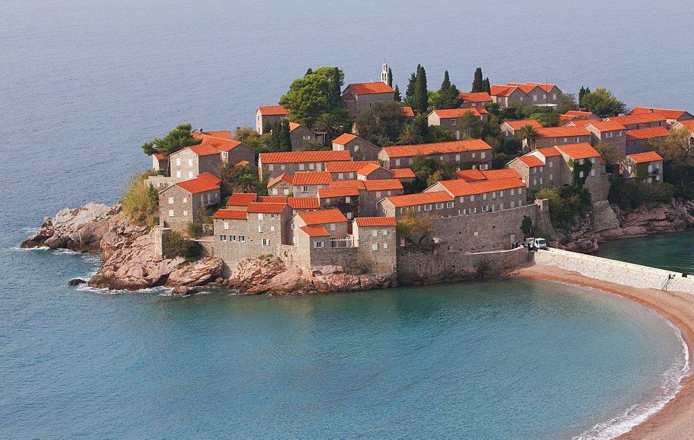Beach and houses on the hotel island at Sveti Stefan on the Adriatic coast, Sveti Stefan, Montenegro, Europe