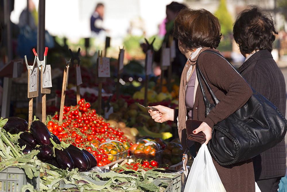 Women shopping in market in Alberobello, Puglia, Italy, Europe