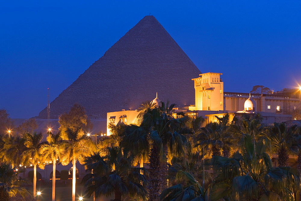 The Great Pyramid , UNESCO World Heritage Site, and the Mena House Hotel in Giza at night, near Cairo, Egypt, North Africa, Africa