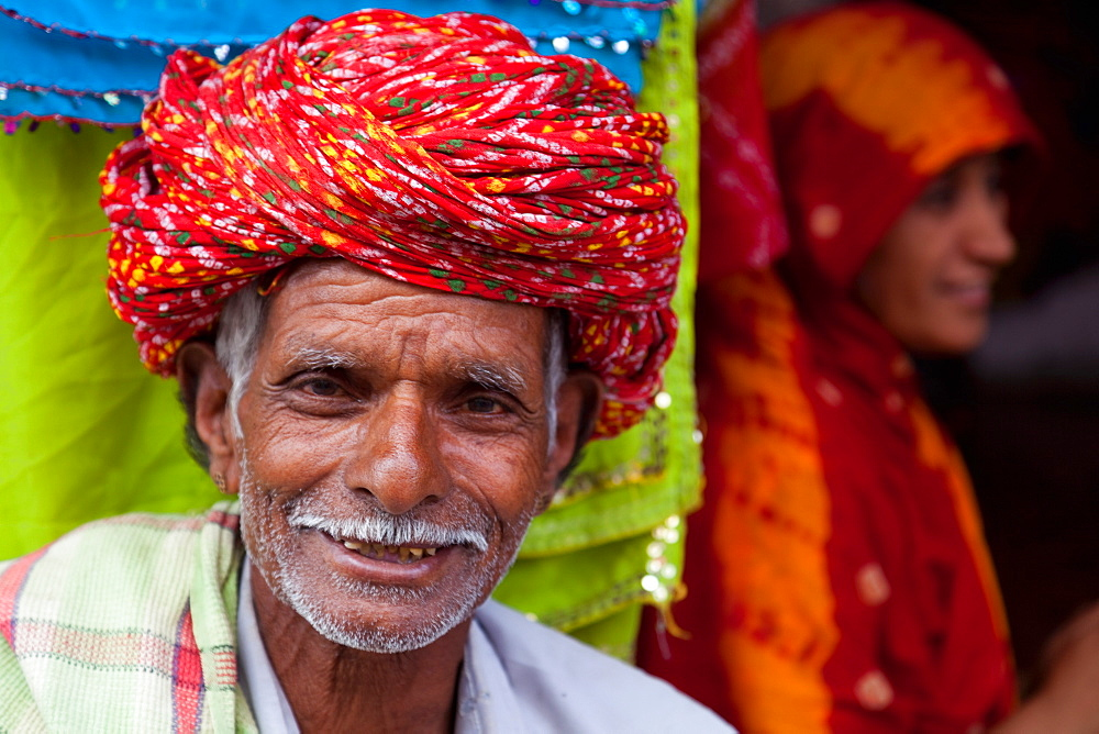 Old man in traditional turban outside a shop in Deogarh, Rajasthan, India, Asia