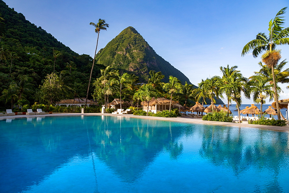 Gros Piton, UNESCO World Heritage Site, and reflection in the swimming pool at Sugar Beach, St. Lucia, Windward Islands, West Indies, Caribbean, Central America