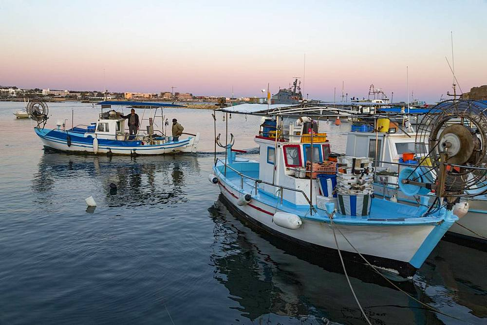 Traditional fishing boats moored in Paphos harbour in southern Cyprus at dusk, Cyprus, Mediterranean, Europe - 785-2351