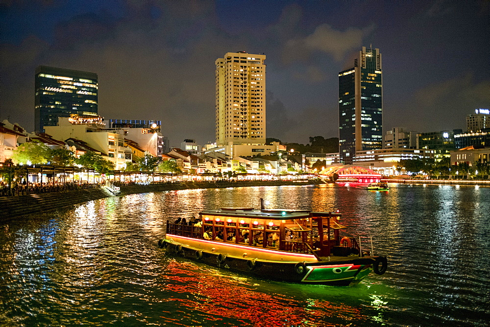 Tourist boat near the historic Boat Quay in Singapore river at dusk - 785-2394