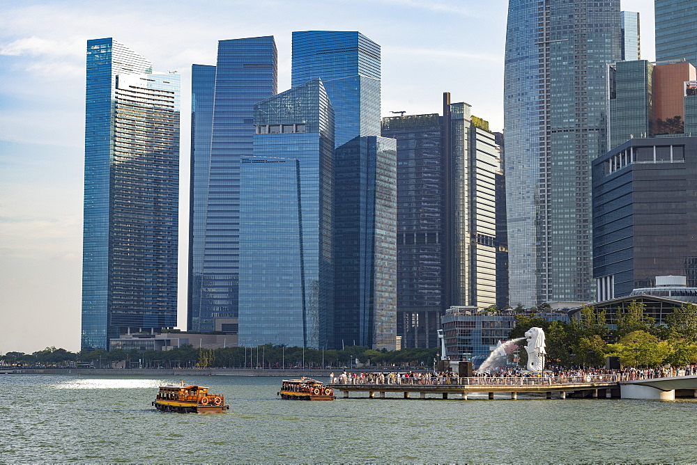 Tourist boats with the Merlion statue and Marina Bay skyline