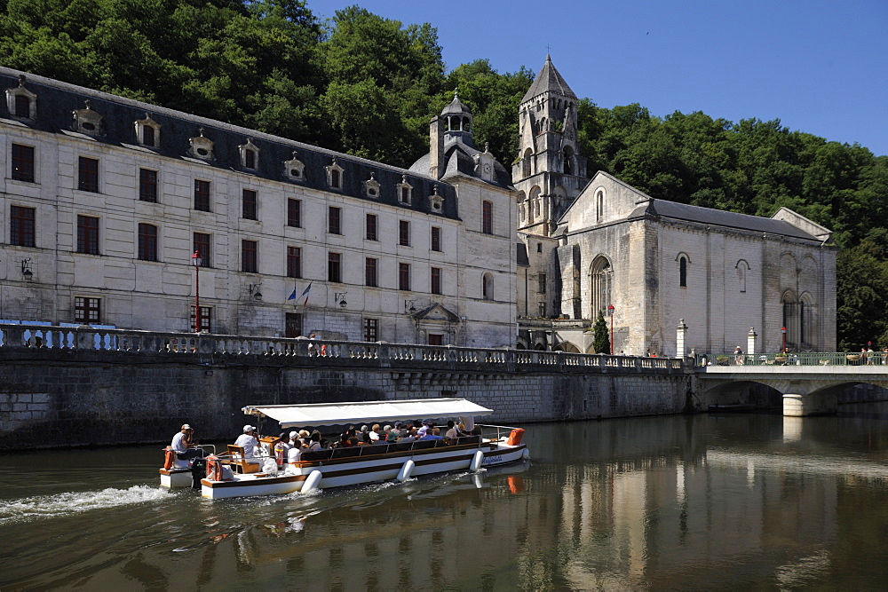 Boat passing in front of the Abbey, Brantome. Dordogne, France. Europe