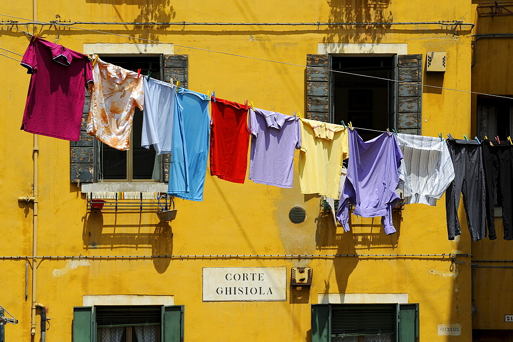Clothes hanging on a washing line between houses, Venice, UNESCO World Heritage Site, Veneto, Italy, Europe