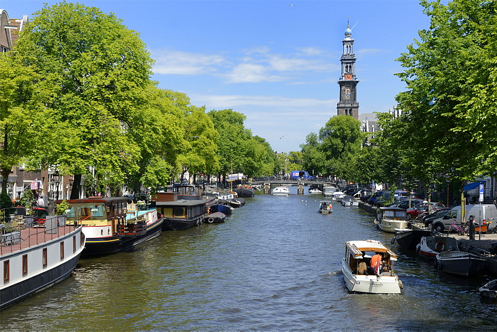 View along Prinsengracht canal, looking towards Westerkerk church, Amsterdam, North Holland, Netherlands, Europe