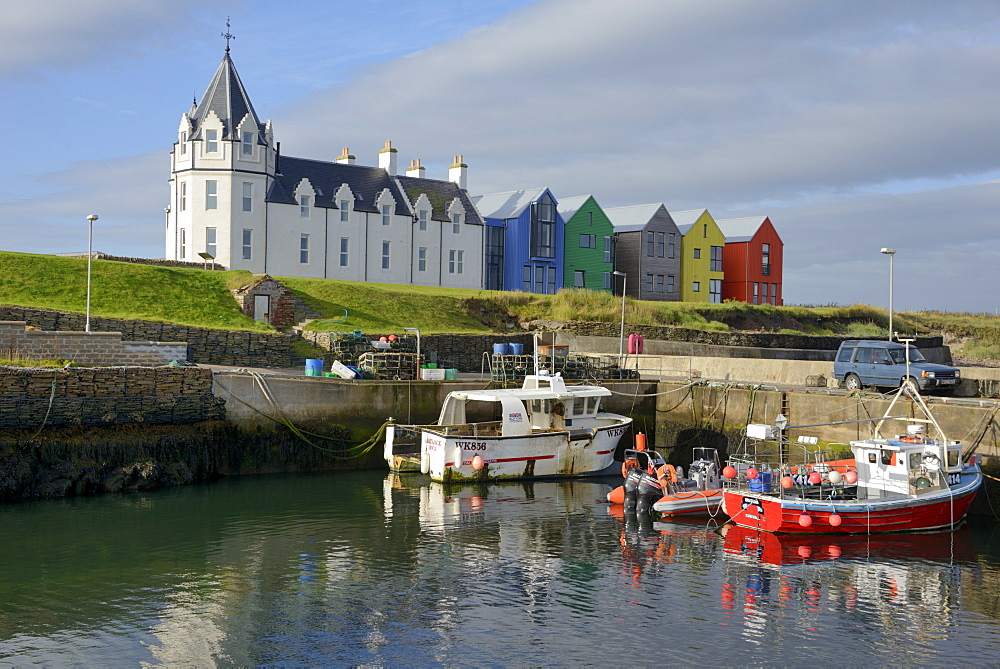 Fishing boats in the harbour and the former John O'Groats Hotel, now luxury self catering apartments, John O'Groats, Caithness, Highland Region, Scotland, United Kingdom, Europe - 792-787