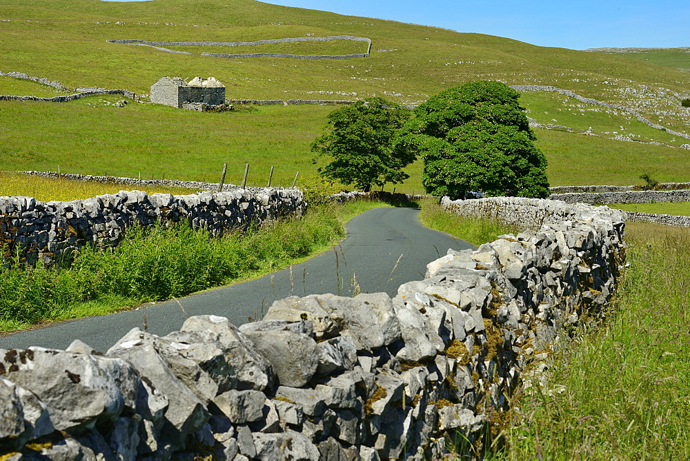 Stone walls lining country road, Ribblesdale Yorkshire Dales National Park, North Yorkshire, England, United Kingdom, Europe - 792-879