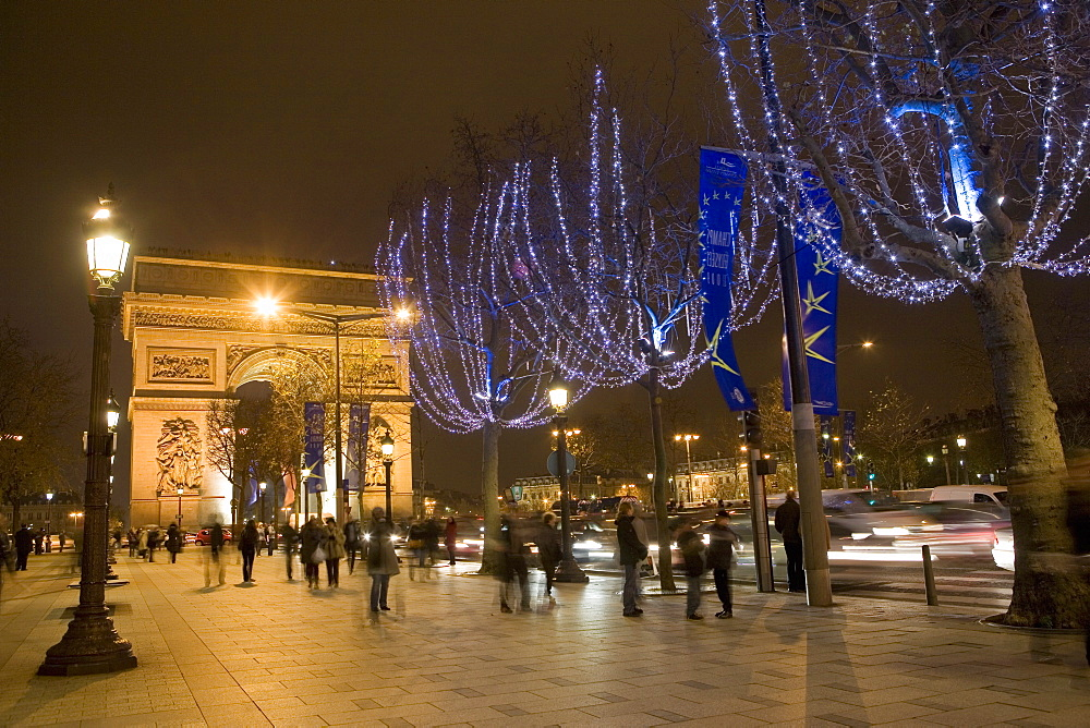 Christmas lights and the Arc de Triomphe, Paris, France, Europe