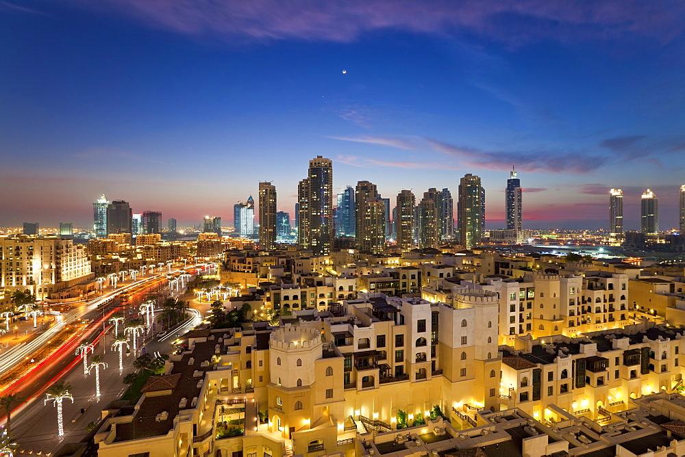 The Palace Hotel in the grounds of the Burj Khalifa park viewed towards the high rises of Dubai Marina area, Dubai, United Arab Emirates, Middle East