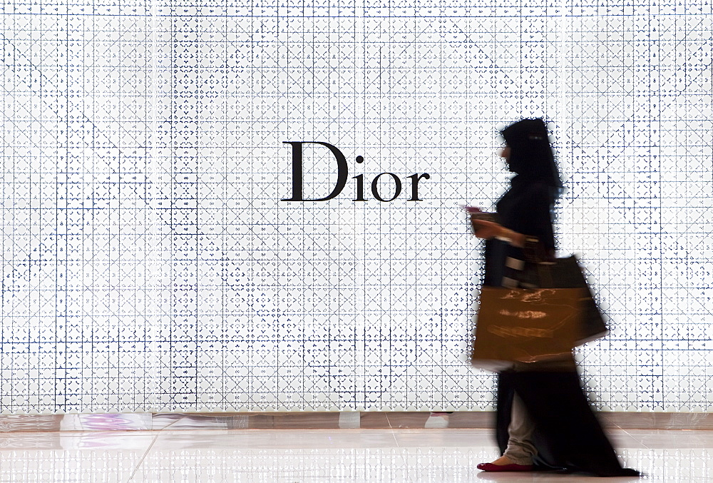 Shopping in the fashion shops of Dubai Mall, the largest shopping mall in the world, built in the grounds of the Burj Khalifa Park, Dubai, United Arab Emirates, Middle East - 794-1102