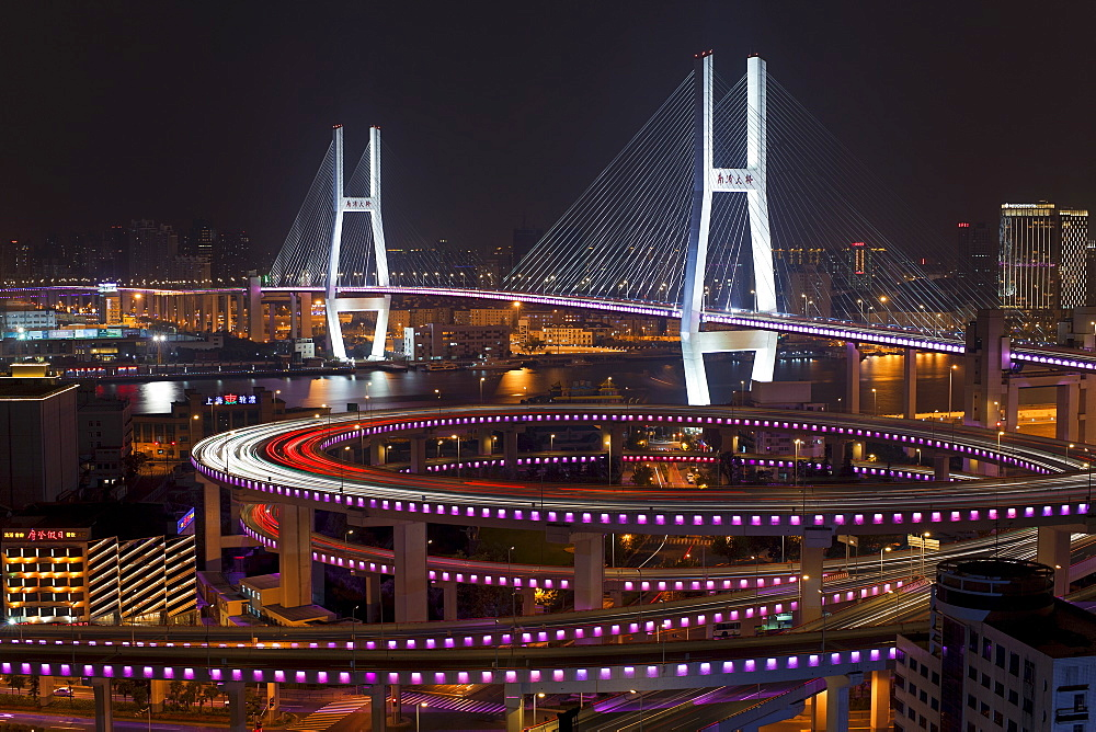 High angle wide shot traffic on Nanpu Bridge spiral and Bridge, illuminated at night, Shanghai, China, Asia - 794-1212