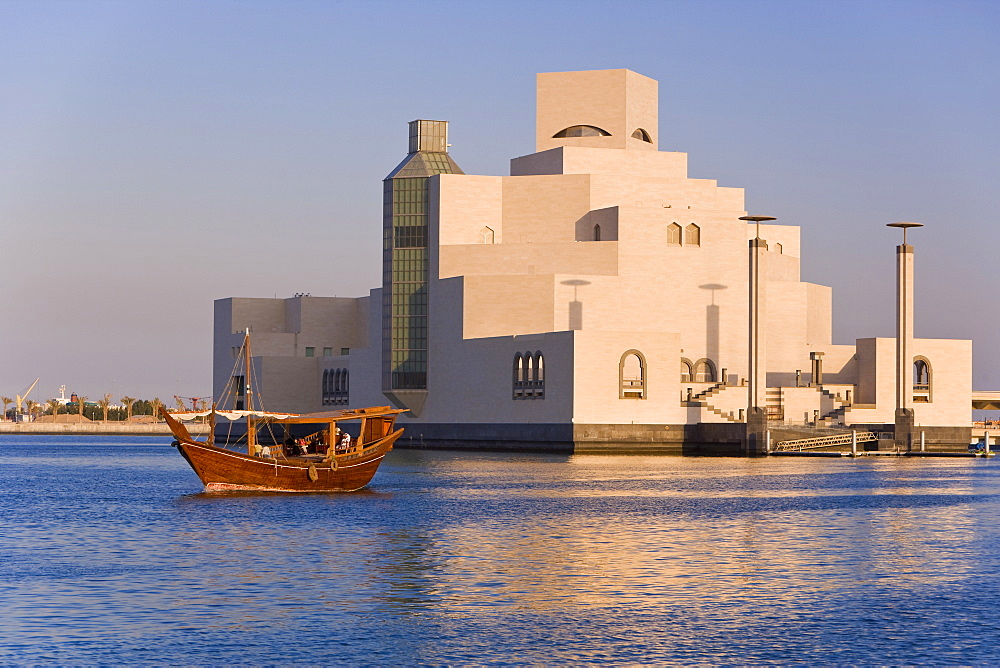 Dhow in front of the Museum of Islamic Art, designed by the renowned architect IM Pei, this museum has the largest collection of Islamic art in the world, Doha, Qatar, Middle East