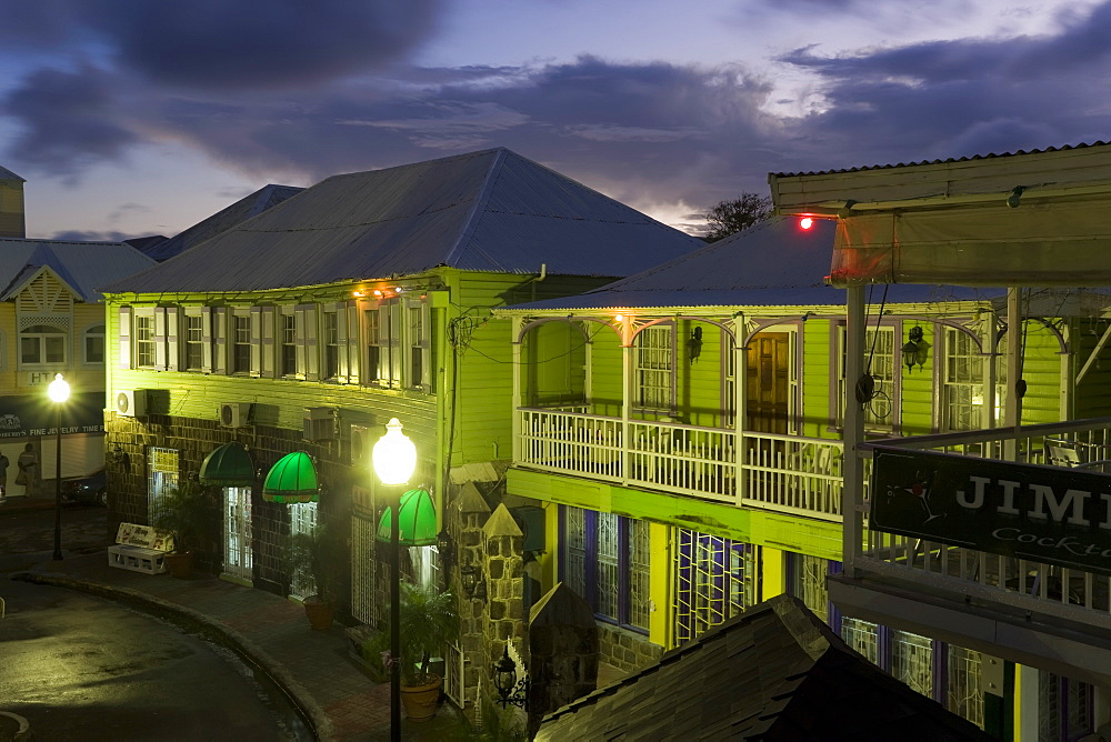 Colourful buildings surrounding the central Piccadilly Circus, illuminated at dusk, Basseterre, St. Kitts, Leeward Islands, West Indies, Caribbean, Central America