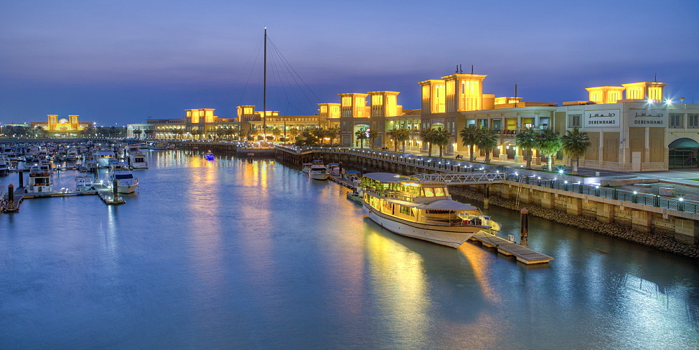 Souk Shark Mall and Kuwait harbour, illuminated at dusk, Kuwait City, Kuwait, Middle East