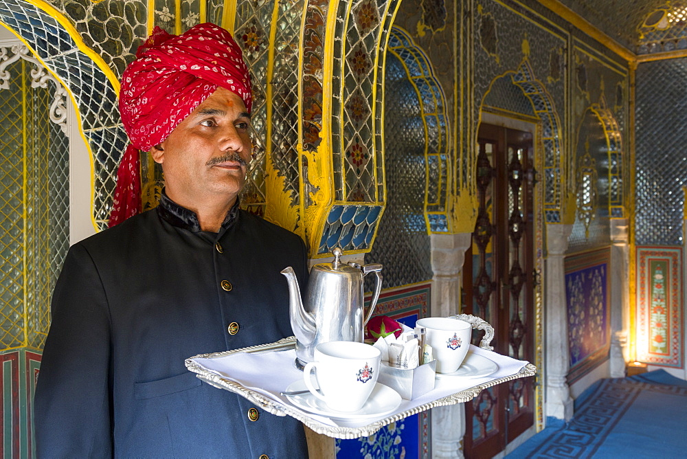 Waiter carrying tea tray in ornate passageway, Samode Palace, Jaipur, Rajasthan, India, Asia - 794-4649