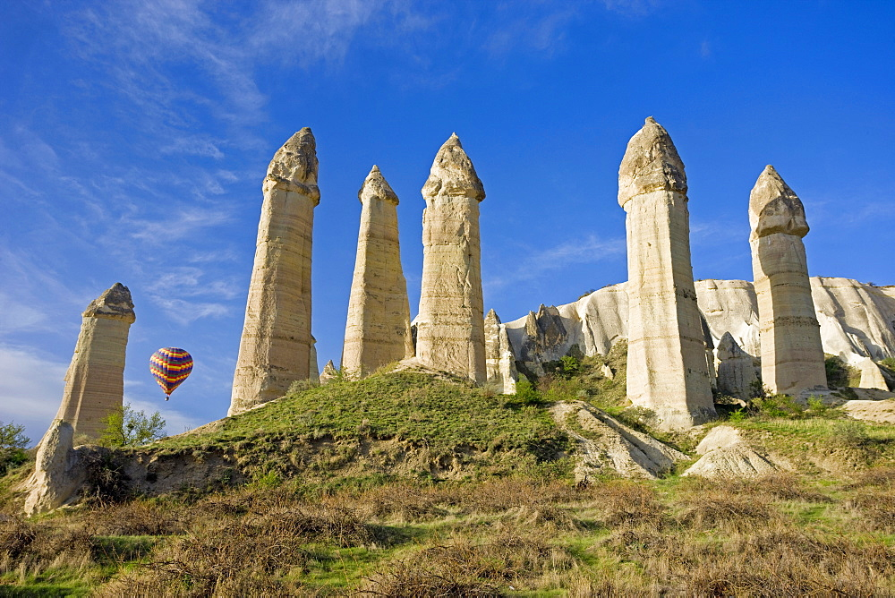 Hot air balloon over the phallic pillars known as fairy chimneys in the valley known as Love Valley near Goreme in Cappadocia, Anatolia, Turkey, Asia Minor, Eurasia - 794-546