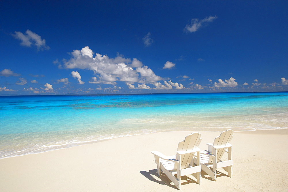 Two deck chairs on tropical beach facing sea, Maldives, Indian Ocean, Asia - 795-12