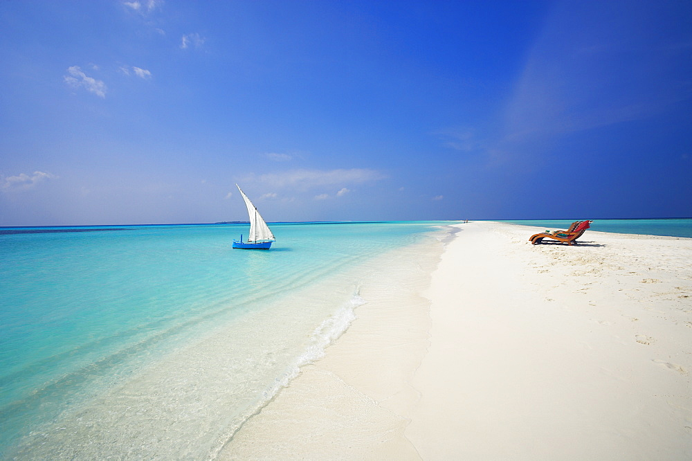 Dhoni and lounge chairs on tropical beach, Maldives, Indian Ocean, Asia