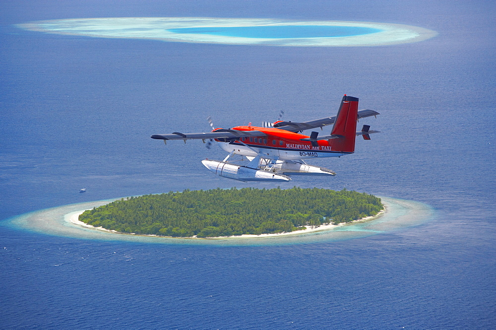 Maldivian Air Taxi flying above island, Maldives, Indian Ocean, Asia - 795-162