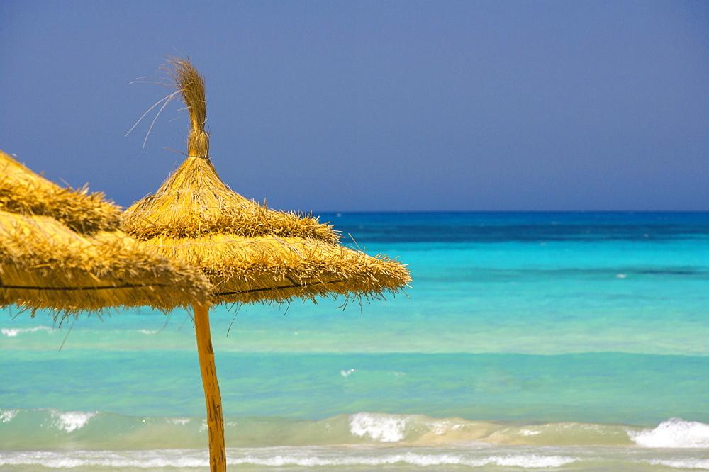 Parasols on beach, Rethymno, Crete, Greek Islands, Greece, Europe