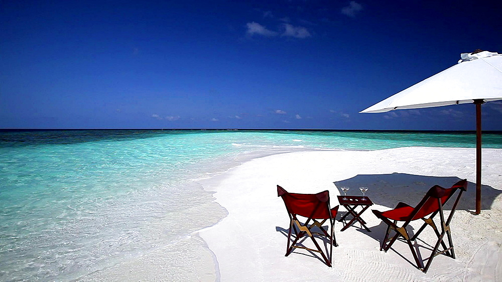 Deck chairs and cocktails on a tropical beach, Maldives, Indian Ocean